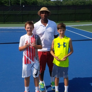 Boys 12s Champion Walker Oberg of Weston, MA and Finalist Marco Pennelli of Wayland, MA